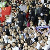 China and Japan Soccer Fans Separated by Police